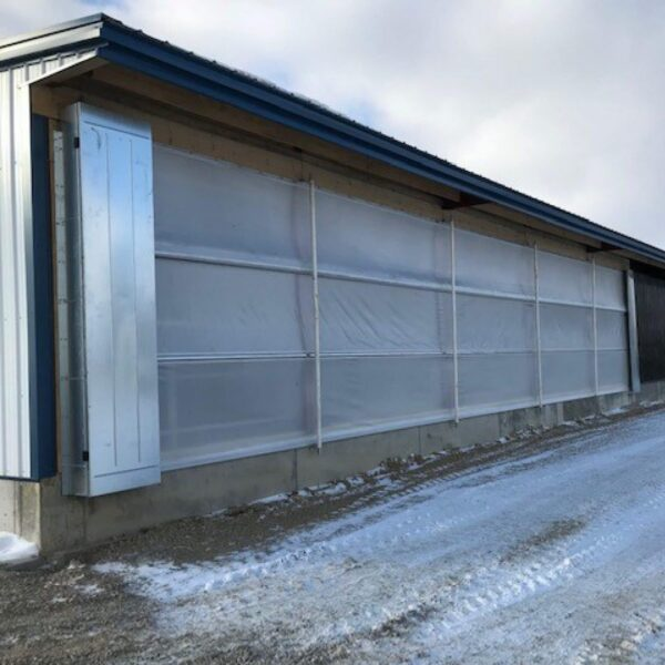Agro Air Dynamics livestock curtains in use on a cow barn.