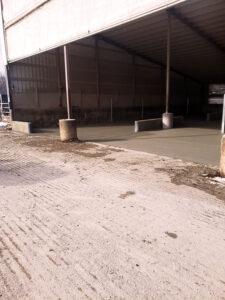 Siebrand Heifer barn fresh concrete pour close-up.